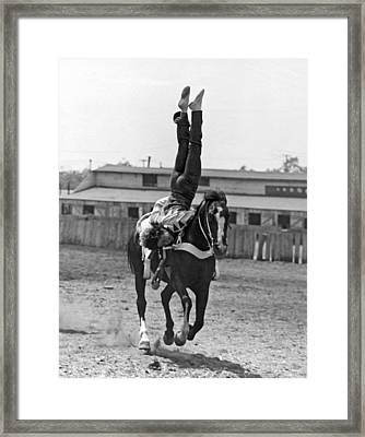 A Head Stand On Horseback Framed Print by -
