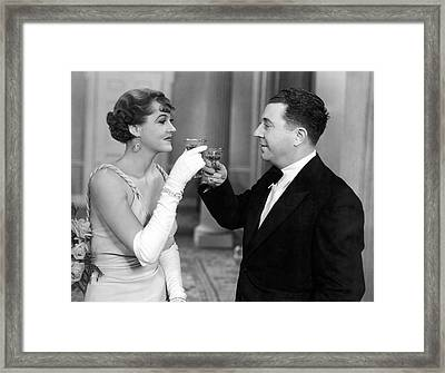 A Man And A Woman Toast Framed Print by Underwood Archives