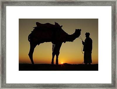 A Man And His Camel Silhouetted Framed Print by Piper Mackay