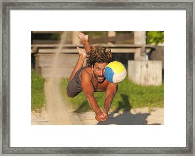 A Man Diving For A Beach Ball Tarifa Framed Print by Ben Welsh