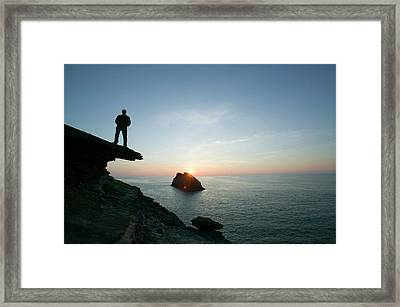 A Man On The Cliff Tops At Boscastle Framed Print by Ashley Cooper
