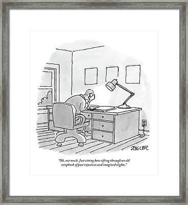 A Man Sits At A Desk Framed Print by Jack Ziegler