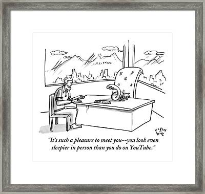 A Man Speaks To A Cat Who Is Asleep On A Desk Framed Print by Farley Katz