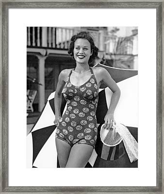 A Miami Logo Bathing Suit Framed Print by Underwood & Underwood