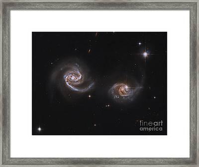 A Pair Of Interacting Spiral Galaxies Framed Print by Roberto Colombari