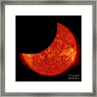 A Partial Solar Eclipse From Space Framed Print by Stocktrek Images