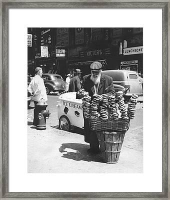 A Pretzel Vendor In New York Framed Print by Underwood Archives