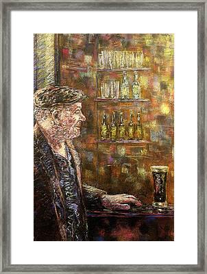 A Quiet Guinness Framed Print by John  Nolan