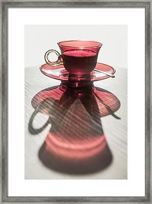 A Red Glass Cup A Saucer Framed Print by Mats Silvan