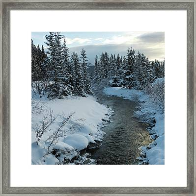 A River Flowing Through A Snow Covered Framed Print by Keith Levit