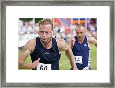A Runner At Ambleside Sports Framed Print by Ashley Cooper