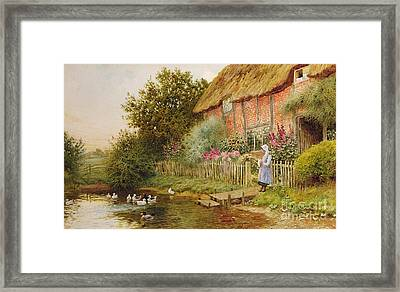 A Rustic Retreat Framed Print by Arthur Claude Strachan