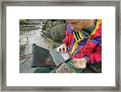 A Scientist Studying Sediment Load Framed Print by Ashley Cooper