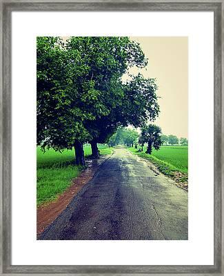 A Simple Road  Framed Print by Girish J