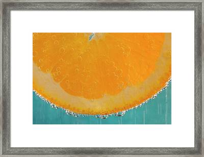 A Slice Of Orange In A Glass Framed Print by Brian Jannsen