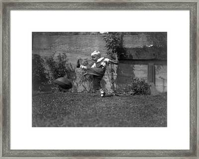 A Small Boy Kicking Football Framed Print by Underwood Archives