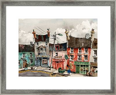 A Street Of Pubs Framed Print by Val Byrne