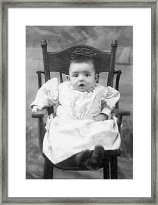 A Surprised Baby Portrait Framed Print by Underwood Archives