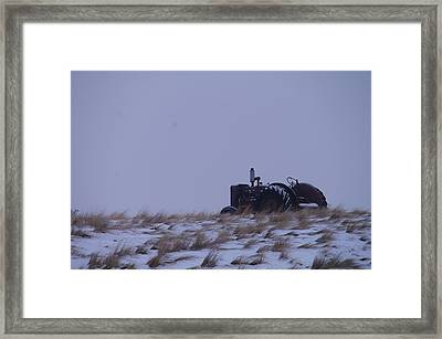 A Tractor Fading To The Snow  Framed Print by Jeff Swan