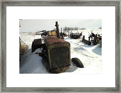 A Tractor In The Snow Framed Print by Jeff Swan