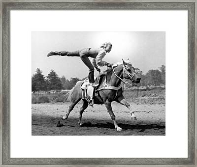 A Trickriding Cowgirl Framed Print by -