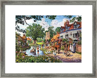 A Village In Summer Framed Print by Steve Crisp