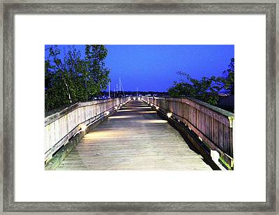 A Walk On The Pier Framed Print by Judy Palkimas