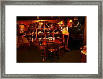 A Wine Rack Framed Print by Jeff Swan