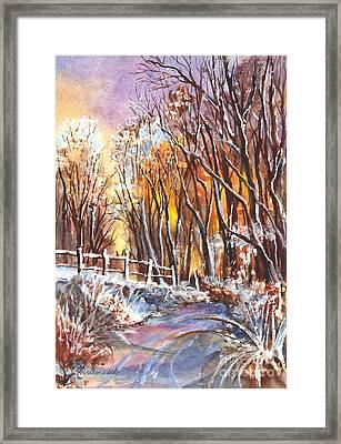 A Firey Winter Sunset Framed Print by Carol Wisniewski