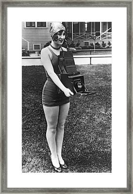 A Woman And Her Camera Framed Print by Underwood Archives
