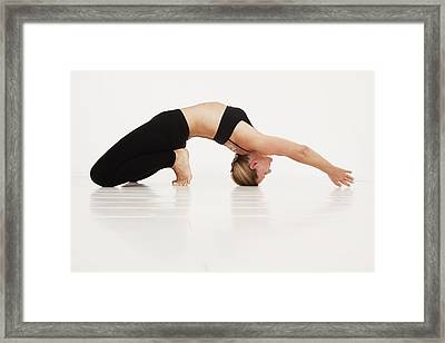 A Woman In A Yoga Pose Tarifa, Cadiz Framed Print by Marcos Welsh