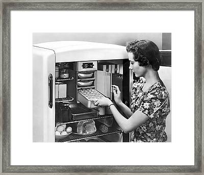A Woman Making Ice Cubes Framed Print by Underwood Archives