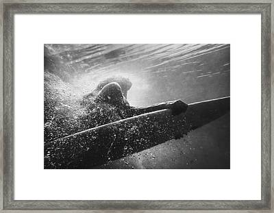 A Woman On A Surfboard Under The Water Framed Print by Ben Welsh