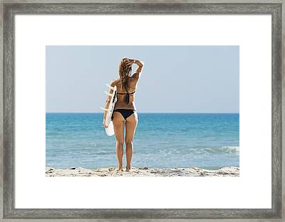A Woman Wearing A Black Bikini Stands Framed Print by Ben Welsh
