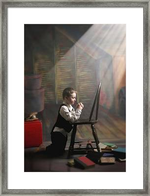A Young Boy Praying With A Light Beam Framed Print by Pete Stec