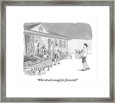 A Young  Man Carries A Box Of Fireworks Framed Print by Trevor Spaulding
