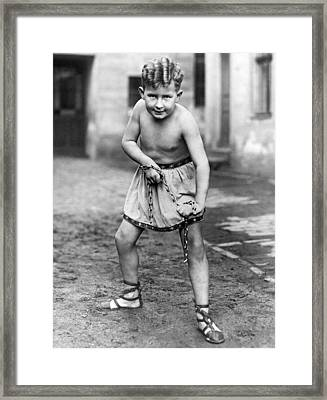 A Youthfull Strongman Framed Print by Underwood Archives