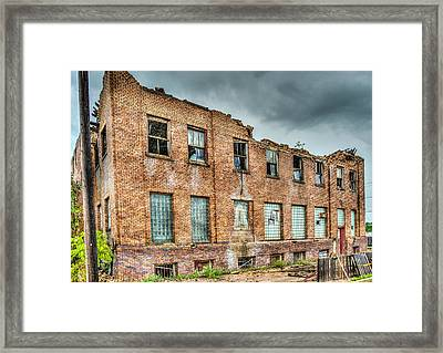Abandoned Brick Building Framed Print by Paul Freidlund