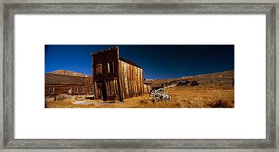 Abandoned Buildings On A Landscape Framed Print by Panoramic Images