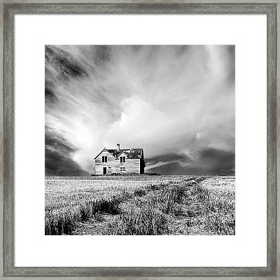 Abandoned Farm House In Stubble Field Framed Print by Donald  Erickson