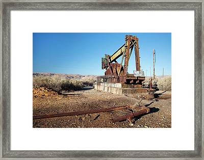 Abandoned Oil Well Framed Print by Jim West
