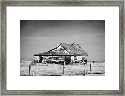 abandoned old wooden farmhouse traditional on farm in rural Canada Framed Print by Joe Fox