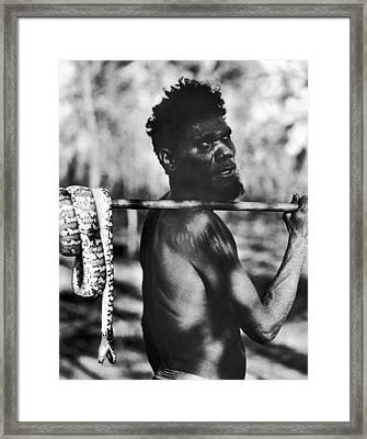 Aborigine With Snake Framed Print by Underwood Archives