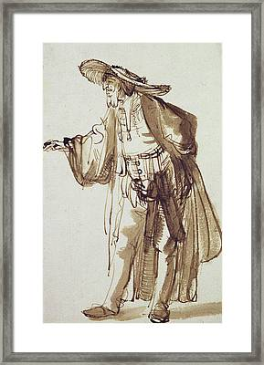 Actor With A Broad-rimmed Hat Framed Print by Rembrandt Harmensz van Rijn