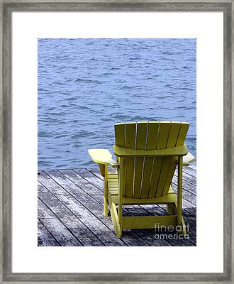 Adirondack Chair On Dock Framed Print by Olivier Le Queinec