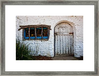 Adobe Door And Window Framed Print by Peter Tellone