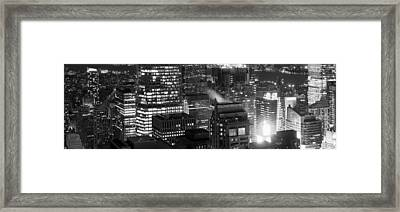 Aerial View Of A City At Night, Midtown Framed Print by Panoramic Images