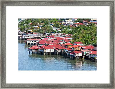 Aerial View Of Houses On Stilts Framed Print by Keren Su