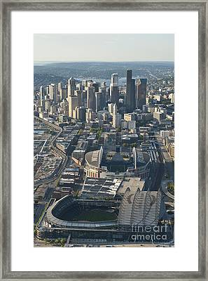 Aerial View Of Seattle Skyline With The Pro Sports Stadiums Framed Print by Jim Corwin