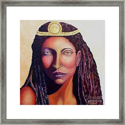 An African Face Framed Print by Caroline Street